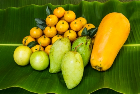 Various tropical fruit on banana leaf . photo