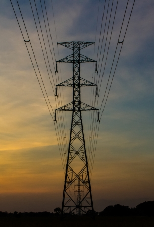 light transmission: Electric transmission tower with sunset light blackground.