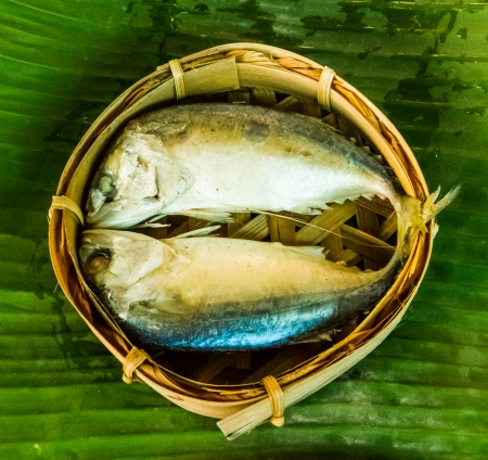 Mackerel fish steamed in bamboo basket . photo