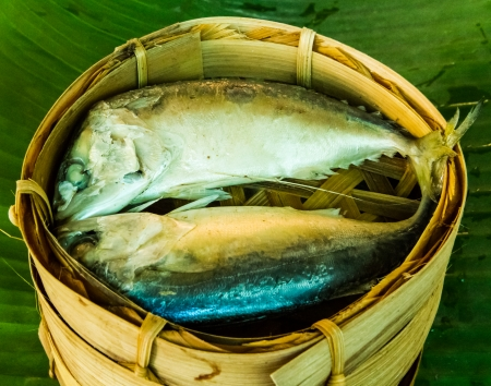 Mackerel fish steamed in bamboo basket   photo