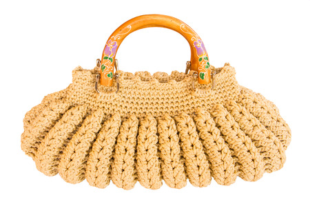 Crocheting hand bag on the white background. photo