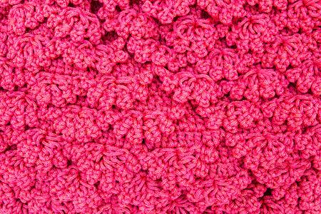 Pink crocheting hand bag close up pattern .