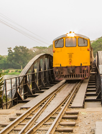 Train running on the  bridge on the river Kwai in Kanchanaburi,Thailand. photo