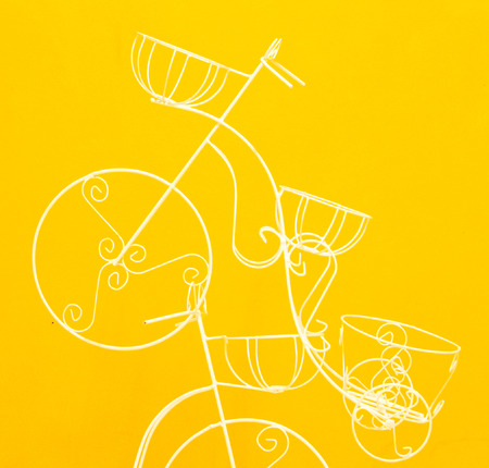 White decorate bicycle in the yellow wall. photo