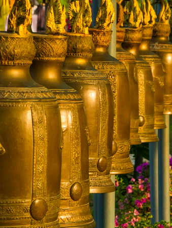 Buddhist golden bells hanging in the temple. photo