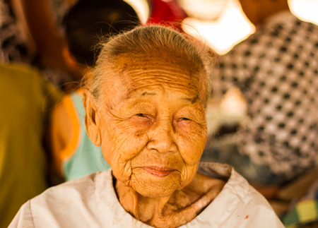 Senior asian woman smiling for camera. photo