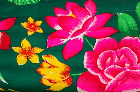 Colorful flowers print mattress close up background. photo