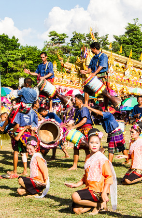 thai dancing: MAHASARAKHAM,THAILAND - MAY 18 : Thai ladies and musician performing Thai music and Thai dancing in Rocket festival Boon Bang Fai parade  on May 18,2014 .This festival for agriculture  to celebration the raining season.