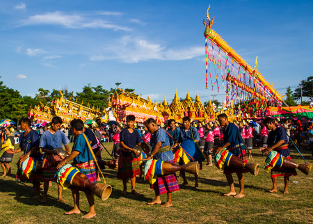 MAHASARAKHAM,THAILAND - MAY 18 : Thai traditional musician performing Thai music  in Rocket festival Boon Bang Fai parade  on May 18,2014 .This festival for agriculture  to celebration the raining season.