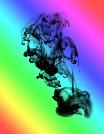 ink drop: Black ink drop in colorful water. Stock Photo