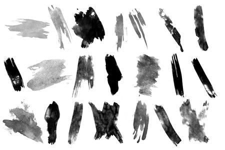 Black ink brush strokes on white background. photo