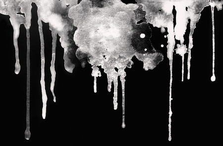 dabs: White ink droped on black background.
