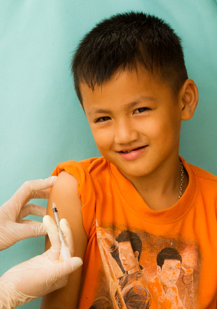 Doctor injecting to a boy. photo