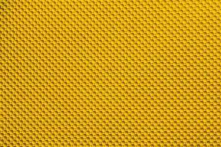 knobby: Knobby yellow rubber close up background. Stock Photo