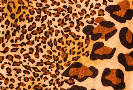 tiger print: Tiger print fabric close  up background.
