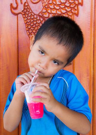 frozen drink: Asian boy enjoying frozen drink. Stock Photo