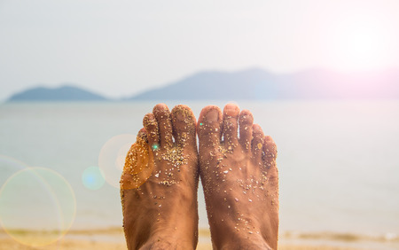 feet in water: Human feet with sea view. Stock Photo