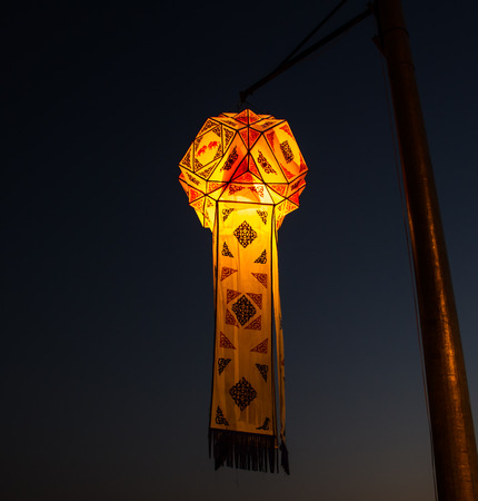 Thai style latern hanging in the night. photo