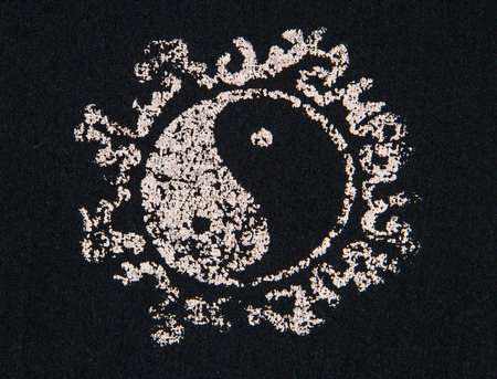 daoism: Close up of Ying yang print fabric. Stock Photo
