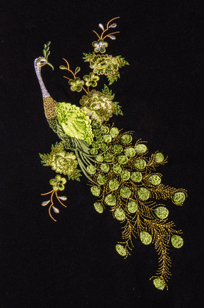 Beautiful peacock embroider on black background.