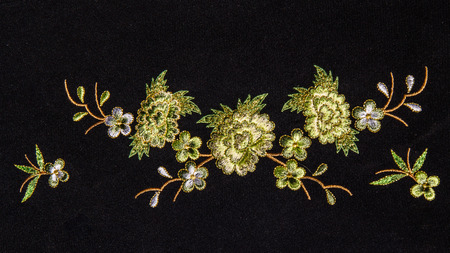 lappet: Beautiful flower embroider on black background.
