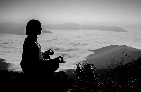 Meditation on  top of the mountain when sunrise.