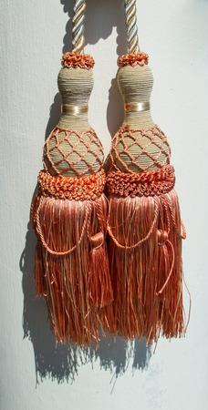 fringe: Classic curtain rope and fringe.