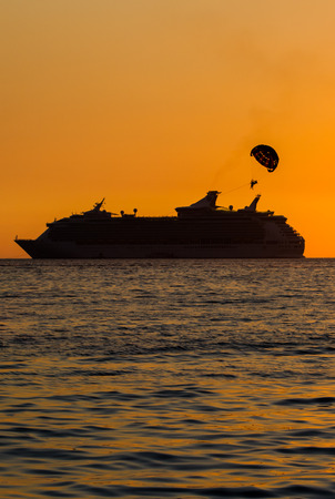 Silhouette of ship in the ocean when sunset. photo