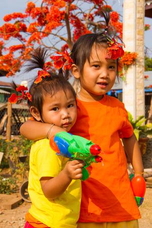 water gun: Girls holding water gun in summer time.