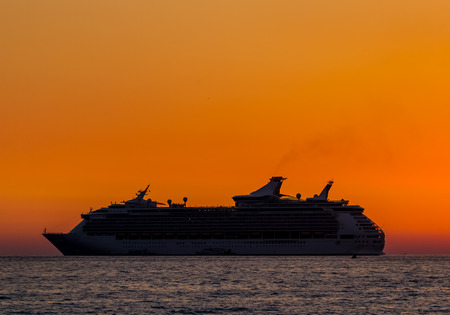 Silhouette of ship when sunset. photo
