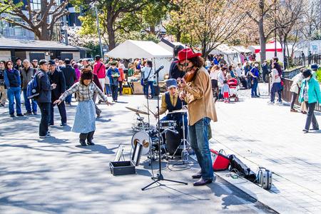 perform: TOKYO,JAPAN-APRIL 2 : Street musicial performance at Ueno park  in Tokyo,Japan for Hanami festival on April 2,2015.Hanami festival start when cherry blossom full bloom. Editorial