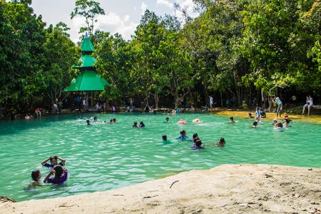 KRABI,THAILAND-MARCH 7 : Tourist enjoy Emerald pool in Krabi,Thailand on March 7,2015.Emerald pool is nature pool in the forest.