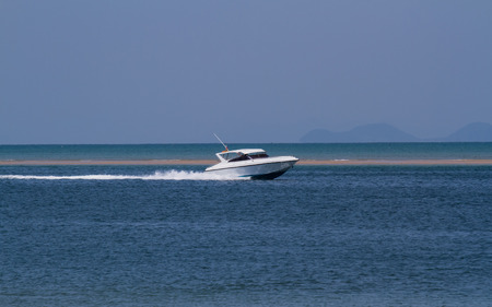 Speed boat running in the sea.