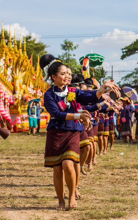 thai dancing: MAHASARAKHAM,THAILAND - MAY 31 : Thai group performing  Thai dancing in Rocket festival   on May 31,2015 .This festival for agriculture  to celebration the raining season.