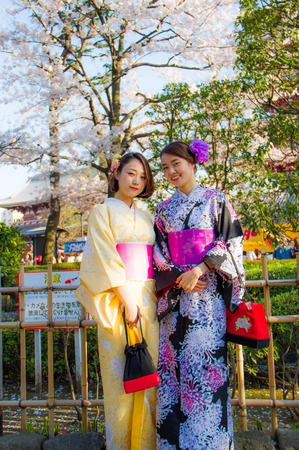 TOKYO,JAPAN-APRIL 2 : Japanese girls wore yukata for join Hanami festival in Tokyo,Japan on  April 2,2015.Hanami festival will start when cherry blossom full bloom. Editoriali