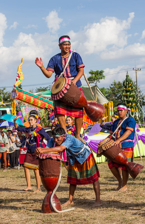 thai dancing: MAHASARAKHAM,THAILAND - MAY 31 : Thai group performing Thai music and Thai dancing  in Rocket festival  on May 31,2015 .This festival for agriculture  to celebration the raining season.