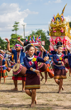 thai dancing: MAHASARAKHAM,THAILAND - MAY 31 : Thai group performing Thai music and Thai dancing in Rocket festival  on May 31,2015 .This festival for agriculture  to celebration the raining season. Editorial