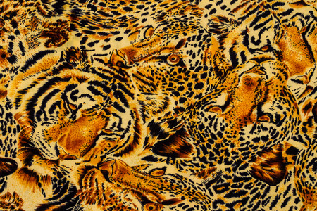 fabric painting: Tiger print fabric close up background.