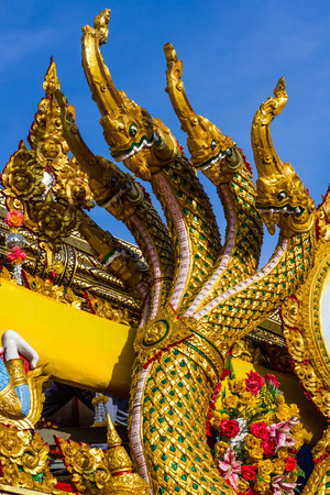thai culture: Naga heads decoration on Rocket festival parade. Stock Photo