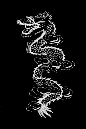 lappet: White dragon sewing on black background.