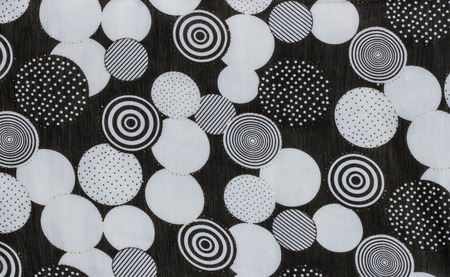 Black and white dot pattern fabric.