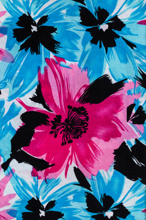 Flower print fabric close up background.