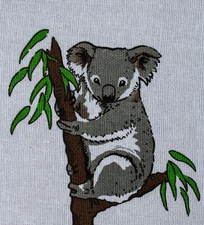 nowhere: Koala on tree print fabric.