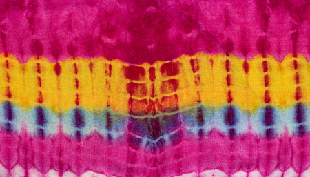 Colorful tie-dye fabric close up background.