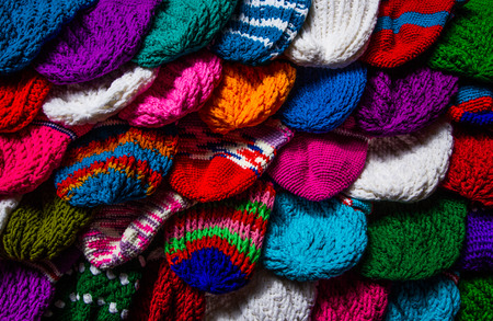purl: Various knitting wool hat background.