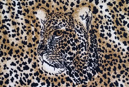 pelt: Tiger print fabric close up background.