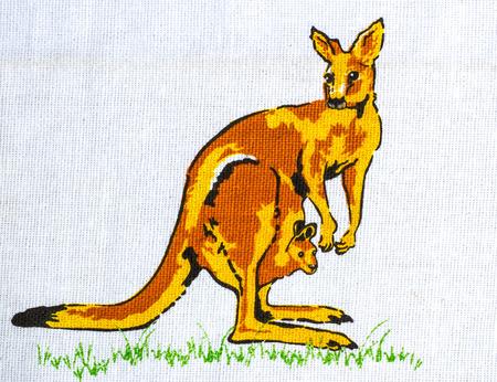 nowhere: Kangaroo holding baby print fabric.