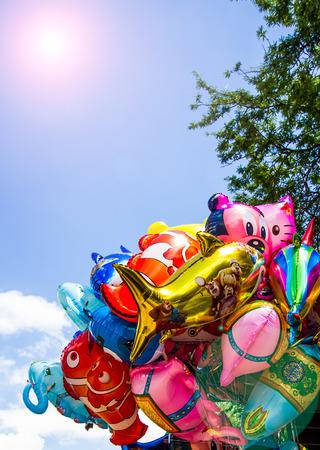 various: Various cartoon balloons floating on air.