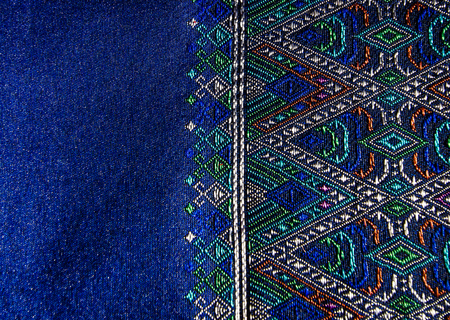 Thai style pattern fabric close up background.