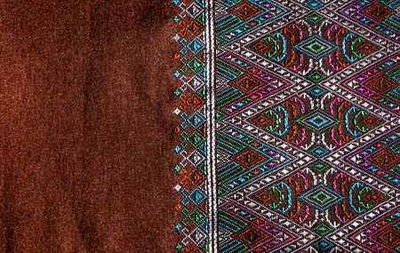 woven: Thai style pattern fabric close up background.